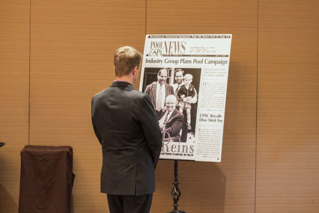 Grandson of California Pools founder, Ryder Steimle, previews a large format photo printing newspaper article