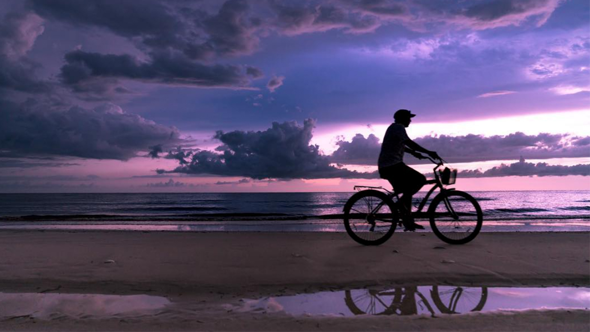 travel photography bike on beach artisanhd